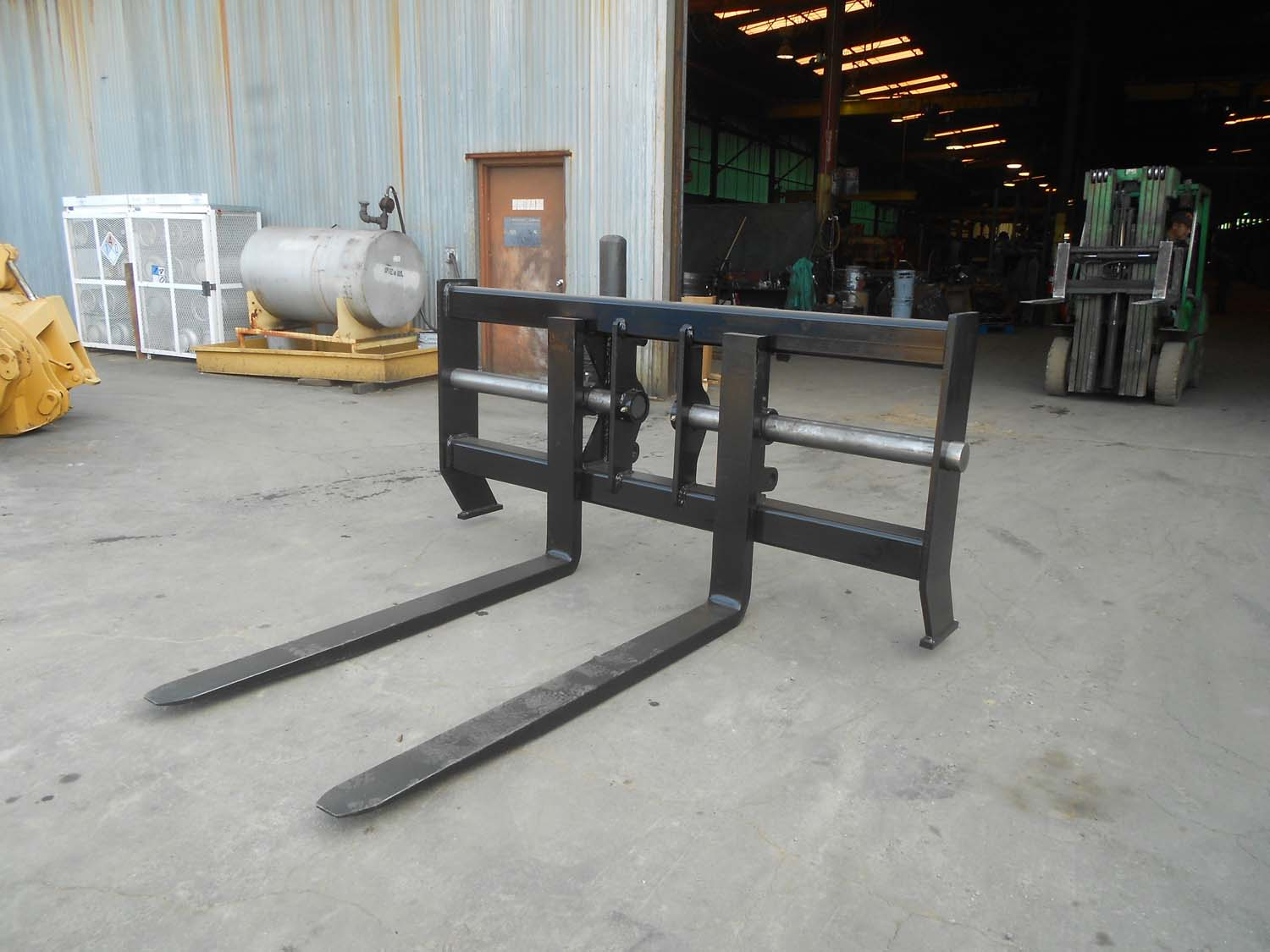 Skid Steer Fork Carriage Attachments